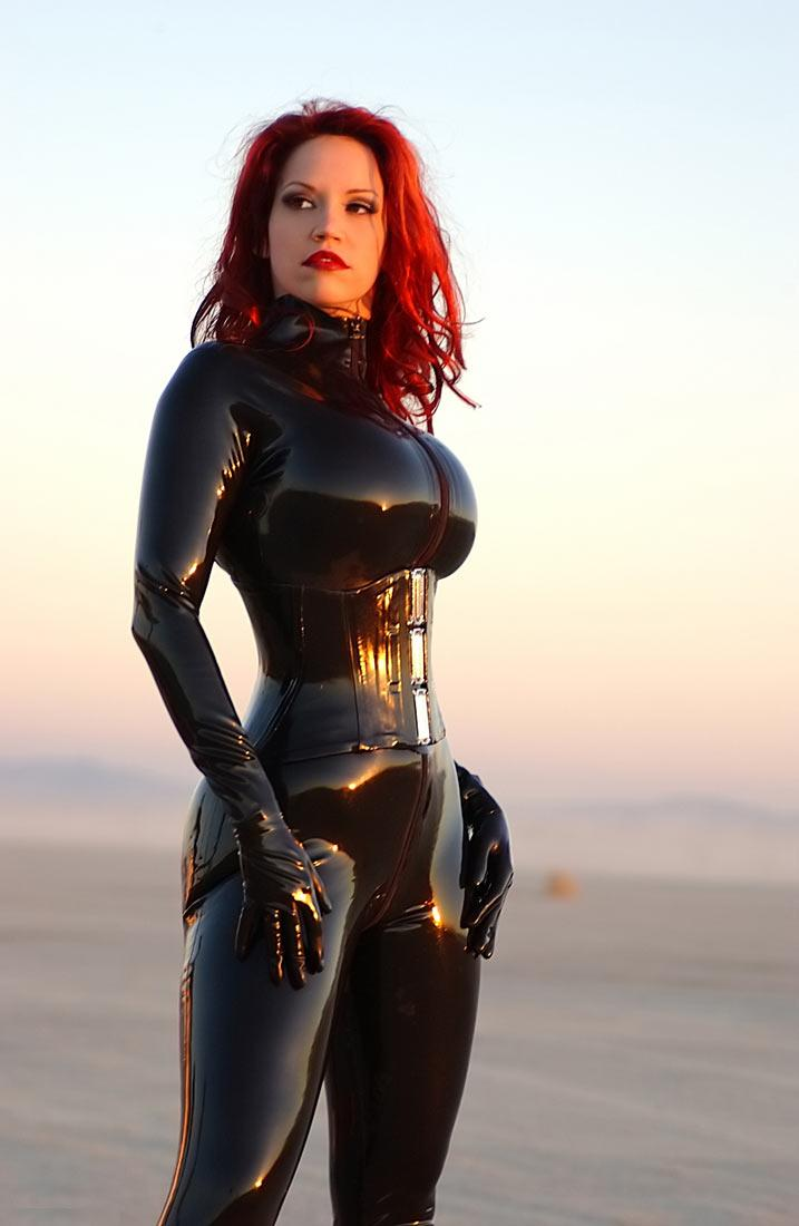Superb redhead in latex suit - Nubile Babes
