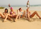 Smokin hot friends in teeny string bikinis spreading their legs