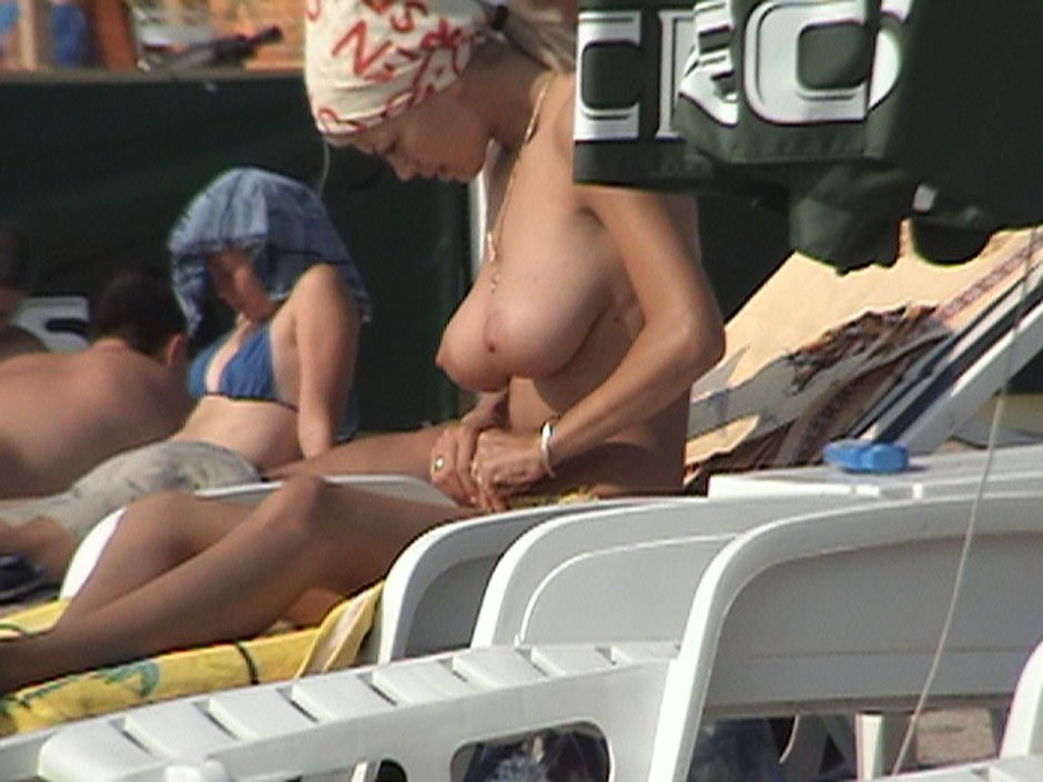 Tempting busty lady caught topless