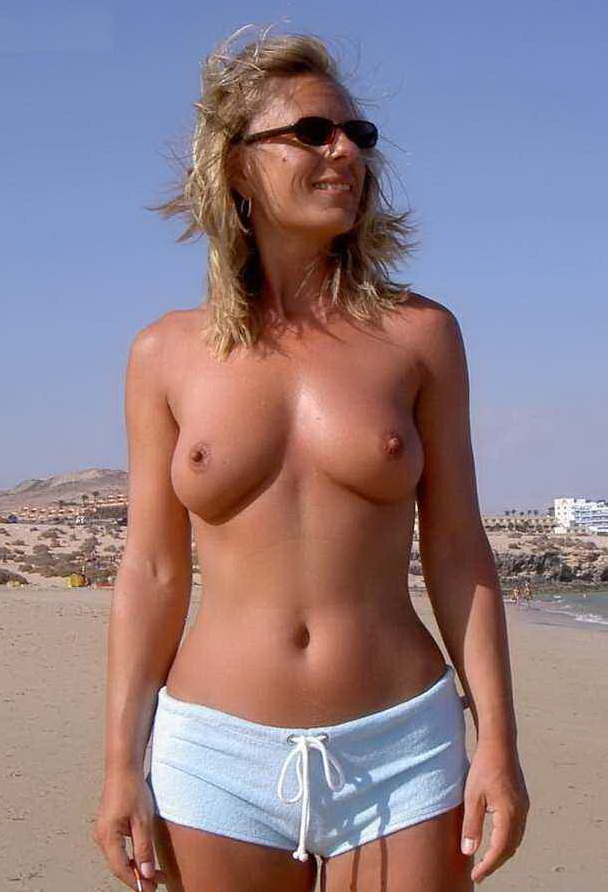 Hot wife topless at the beach