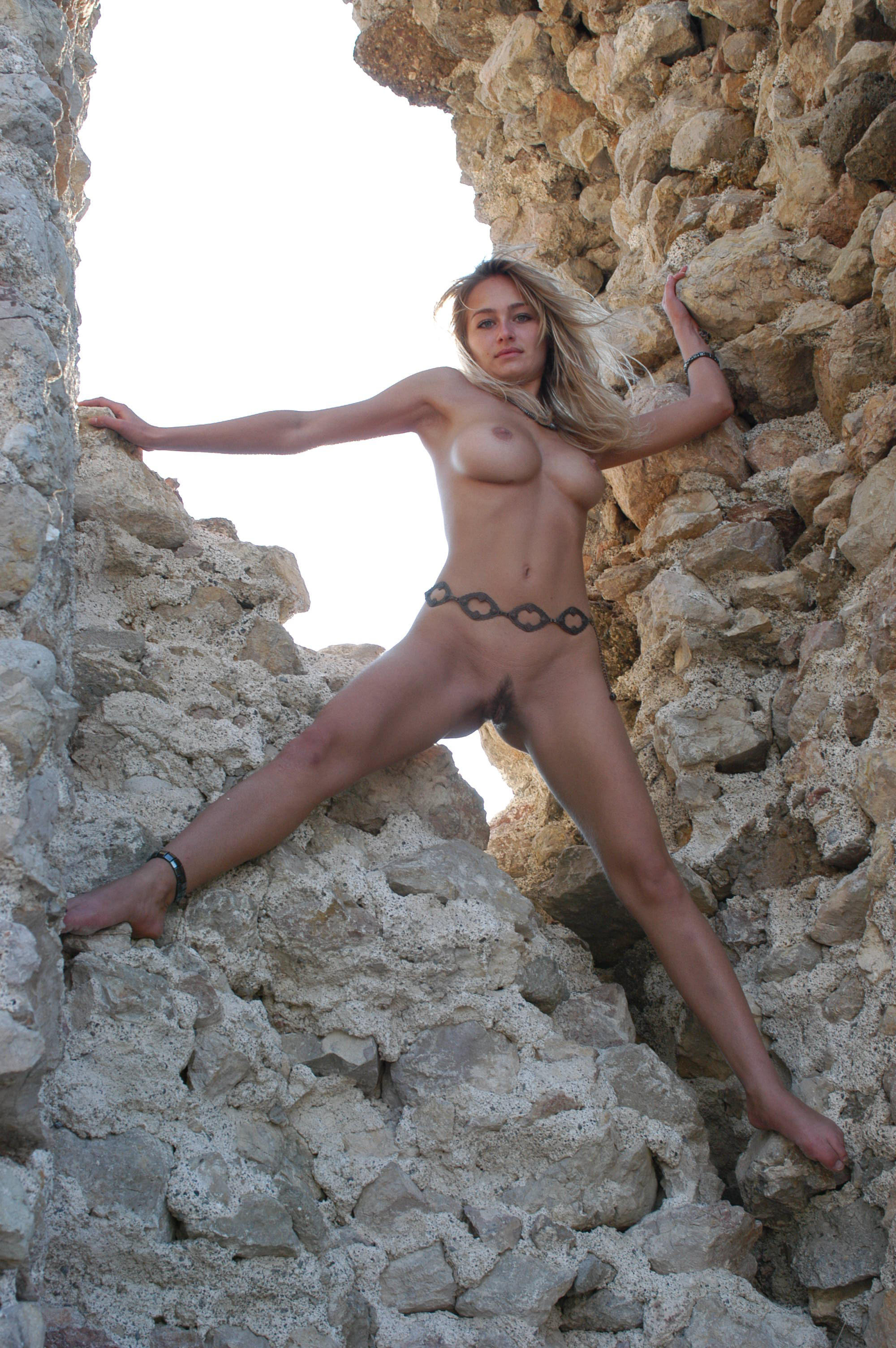 Athletic goddess naked spread eagle on rocks
